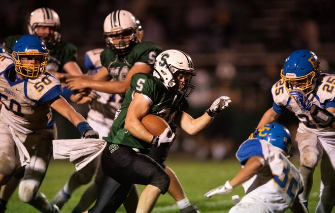 Smithville's Skylar Mullins leaves East Canton defenders grasping at nothing during his game-winning 20-yard run.