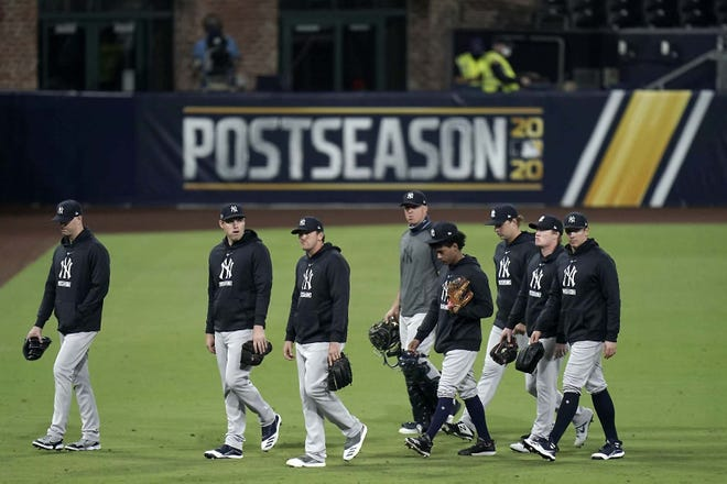 New York Yankees pitchers leave the field Friday after the team's 2-1 loss to the Tampa Bay Rays in Game 5 of an American League Division Series in San Diego. [JAE C. HONG / AP]