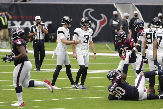 Jaguars punter and holder Logan Cooke consoles Stephen Hauschka (3) after he missed a field-goal attempt last week in Houston.