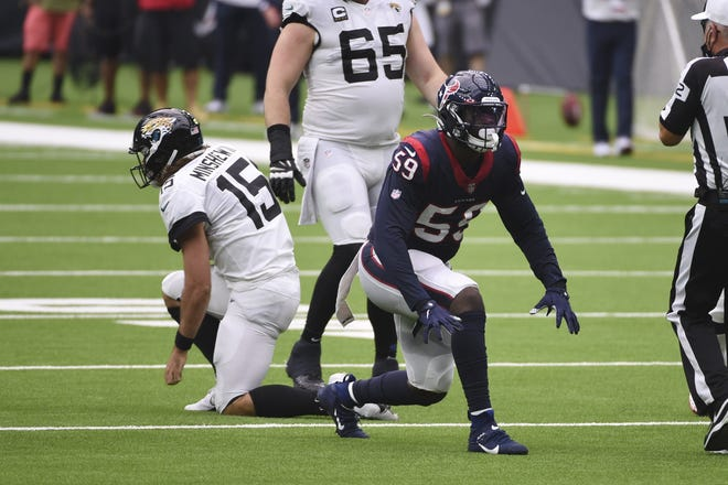 Houston Texans outside linebacker Whitney Mercilus (59) celebrates after the sacked Jacksonville Jaguars quarterback Gardner Minshew (15) for a loss during the second half of an NFL football game Sunday, Oct. 11, 2020, in Houston. (AP Photo/Eric Christian Smith)