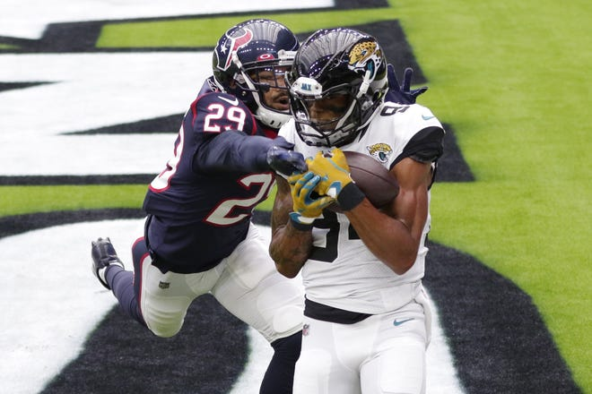 Jacksonville Jaguars wide receiver Keelan Cole (84) catches a pass over Houston Texans cornerback Phillip Gaines (29) for a touchdown in the teams' Oct. 11 meeting.