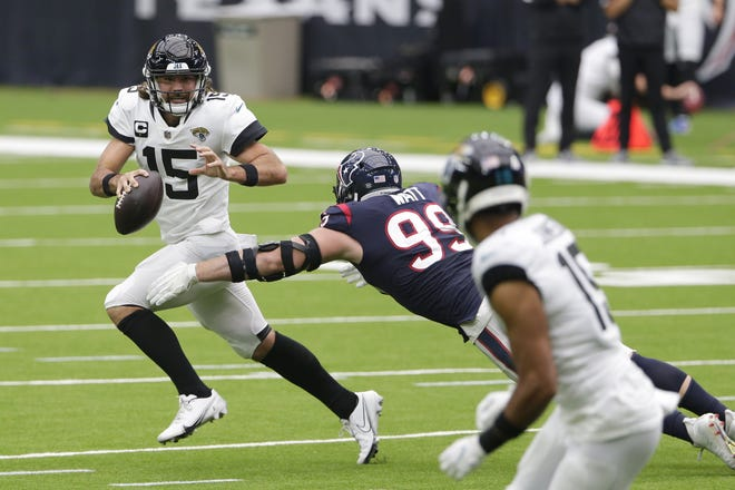 Jaguars quarterback Gardner Minshew tries to escape Houston's J.J. Watt on Sunday.