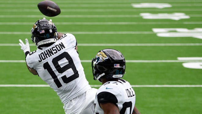 Jaguars wide receiver Collin Johnson leaps to make his first NFL touchdown reception on Sunday at Houston.
