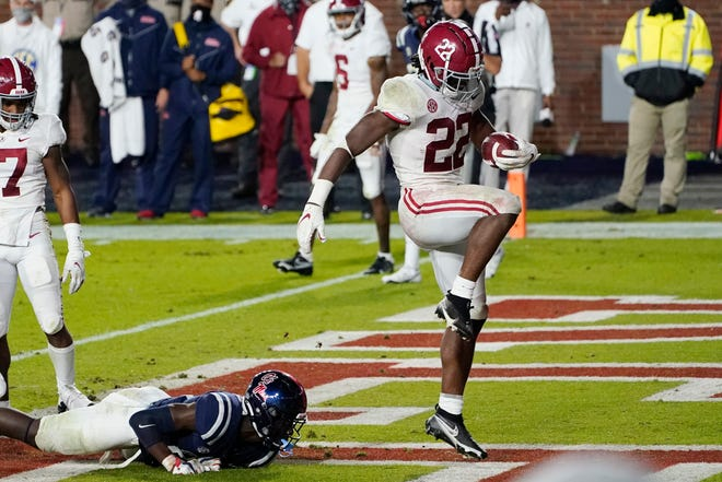 Alabama running back Najee Harris (22) dances after breaking a Mississippi tackle and scoring a touchdown during the first half of an NCAA college football game in Oxford, Miss., on Saturday.