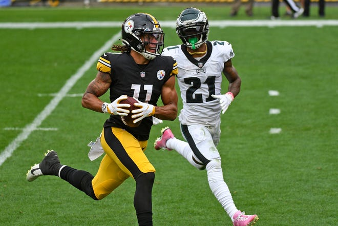 Pittsburgh Steelers wide receiver Chase Claypool (11) beats Philadelphia Eagles strong safety Jalen Mills (21) to the end zone for a touchdown during the first half in Pittsburgh on Sunday.