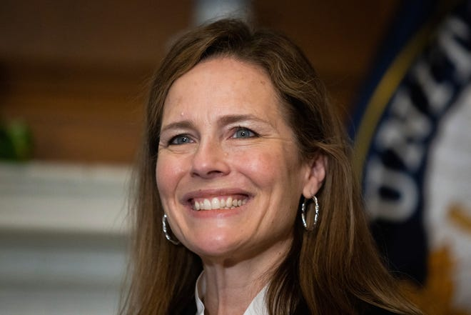 Supreme Court nominee Judge Amy Coney Barrett, meets with Sen. Roger Wicker, R-Miss., at the Capitol in Washington earlier this month. Confirmation hearings begin Monday Barrett. If confirmed, the 48-year-old appeals court judge would fill the seat of liberal Justice Ruth Bader Ginsburg, who died last month.