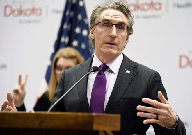 North Dakota Gov. Doug Burgum speaks in April at the state Capitol in Bismarck, N.D. Hospitalizations from COVID-19 have hit their highest points recently throughout the Midwest, where the growth in new cases has been the worst in the nation. Burgum acknowledges his state's numbers are moving in the wrong direction as it hit new highs for active and newly confirmed cases, as well as hospitalizations. But he's also touting the state's test positivity staying in the 7% range.