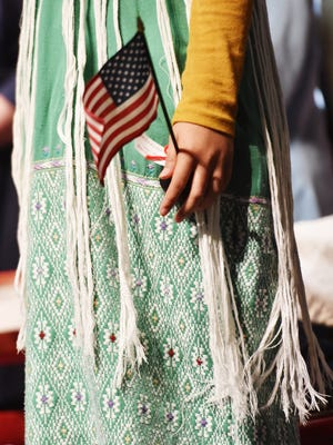 New American citizens get sworn in during a naturalization ceremony Friday, Nov. 15, 2019 at Mohawk Valley Community College in Utica.