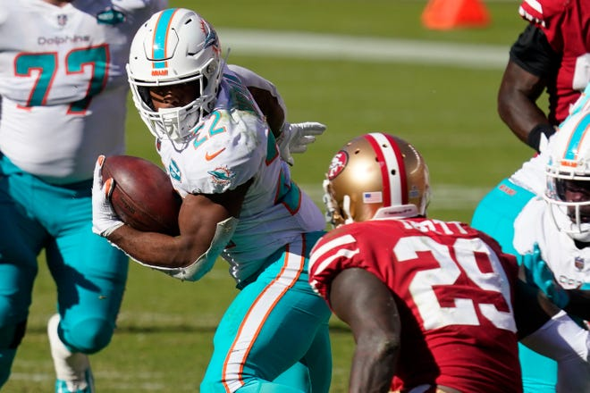 Miami Dolphins running back Matt Breida (22) runs against the San Francisco 49ers during the second half of an NFL football game in Santa Clara, Calif., Sunday, Oct. 11, 2020.