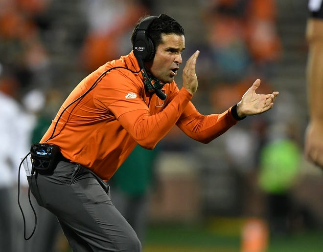 Miami coach Manny Diaz urges on his team during a 42-17 loss at Clemson Saturday. [ACC Pool/Bart Boatwright/The Clemson Insider]