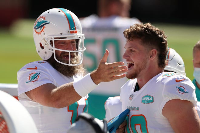 Dolphins quarterback Ryan Fitzpatrick celebrates with tight end Adam Shaheen, who caught a touchdown pass during Sunday's win over the 49ers.