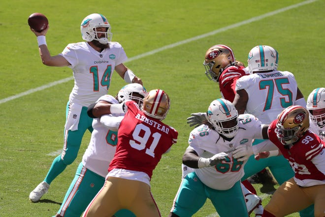 Dolphins quarterback Ryan Fitzpatrick passes against the 49ers during the first half Sunday in Santa Clara, Calif. Fitzpatrick went 22 of 28 for 350 yards and three TDs to lead the upset over the 49ers.