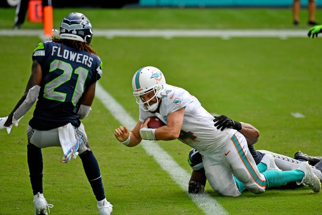 Dolphins quarterback Ryan Fitzpatrick runs for a touchdown against the Seahawks last Sunday at Hard Rock Stadium.