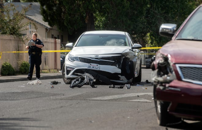A Stockton police officer investigates the scene of a fatal shooting on East Marsh Street between South Windsor and South Golden Gate avenues in east Stockton on Saturday afternoon.