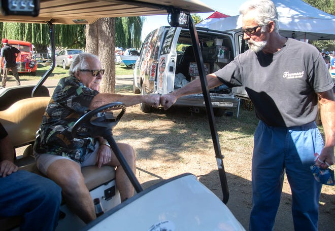 Pete Paulsen, left, who says the 31st annual Hot Rod Party car show in French Camp will be his last, gets a fist bump from Ken Herder of Manteca on Sunday. The 83-year-old Paulsen has been holding the show for the past 31 years to raise money for local charities and to meet people in the community.