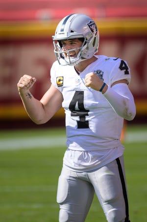 Las Vegas Raiders quarterback Derek Carr (4) celebrates after the Raiders scored a touchdown against the Kansas City Chiefs during an NFL football game, Sunday in Kansas City, Mo.