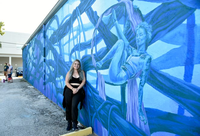 "Sarasota native Danielle Dygert, 27, on Saturday unveiled her latest mural, a commission from the city of Sarasota and the Arts and Cultural Alliance of Sarasota County, on the wall of a building that houses antique stores on Fruitville Road. She describes it as a ""pyschofigurative landscape, a response to a childhood memory at the Ringling Museum."""