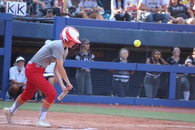 Dale's Anna Hester lays down a bunt-single against Latta Saturday in the Class 2A State Fastpitch Tournament championship game at Hall of Fame Stadium in Oklahoma City.