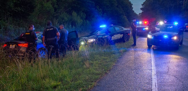 Deputies with the Randolph County Sheriff's Office search a vehicle in Asheboro in June.