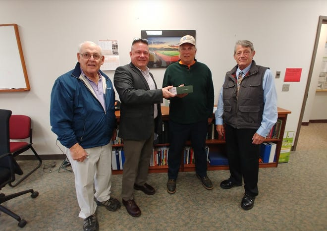Lions President Dave Foster presents hearing aids to Ralph Vaughn Jr. along with Mike Donohue and Tom Farmer of the Speech and Hearing Committee.