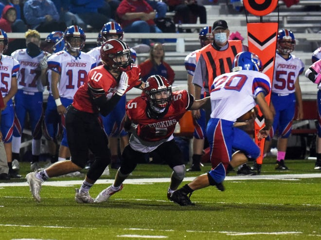 Coshocton's Tucker Nelson reaches to tackle Zane Trace tailback Logan McDowell in a playoff game last season. Nelson will continue his career with Marietta College where he will be a wide receiver.