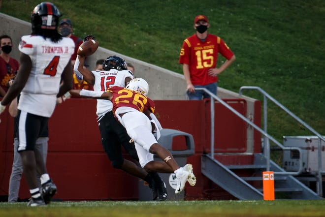 Texas Tech wide receiver Ja'Lynn Polk (12) battles Iowa State defensive back Anthony Johnson (26) during a game last season. Polk caught 28 passes for 264 yards and two touchdowns as a freshman last year, but announced Monday he plans to transfer.