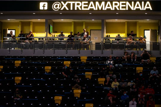 Fans sit in box suites during the USA Wrestling Senior National Championships, Sunday, Oct. 11, 2020, at the Xtream Arena in Coralville, Iowa.