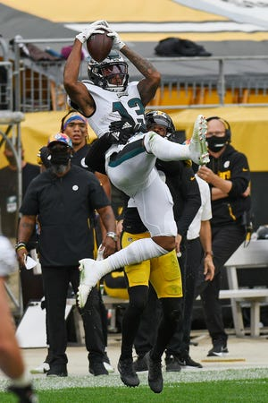 Eagles receiver Travis Fulgham makes a catch with on Steelers cornerback Steven Nelson Sunday.