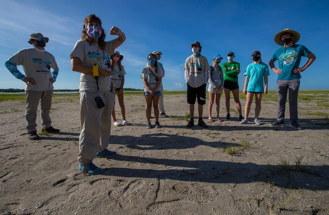 Susie Hassett instructs volunteers from Sea Scouts prior to a beach cleanup on Fort Myers Beach, sanctioned by Keep Lee County Beautiful.