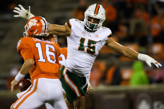 Miami defensive end Jaelan Phillips pressures Clemson's Trevor Lawrence in a clash of likely first-round draft picks.