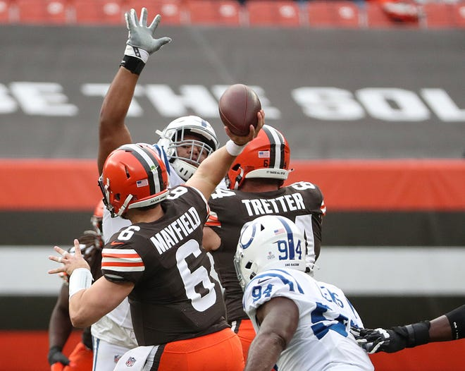 Browns quarterback Baker Mayfield passes during the first quarter of Sunday's game against the Colts.