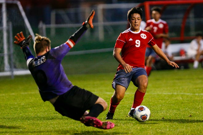 Rensselaer's Elijah Gastineau (0) goes out of the box to block West Lafayette's Austin Pacheco (9) during the first half of the IHSAA Sectional No. 18 boys soccer championship game, Saturday, Oct. 10, 2020 in West Lafayette.