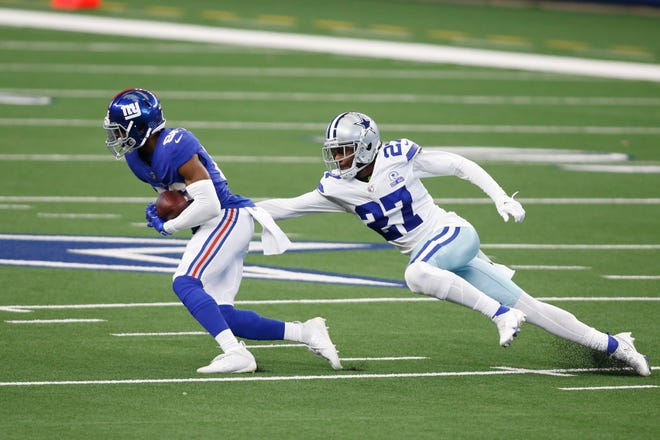 Oct 11, 2020; Arlington, Texas, USA; New York Giants wide receiver Darius Slayton (86) catches a pass against Dallas Cowboys cornerback Trevon Diggs (27) in the first quarter at AT&T Stadium. Mandatory Credit: Tim Heitman-USA TODAY Sports