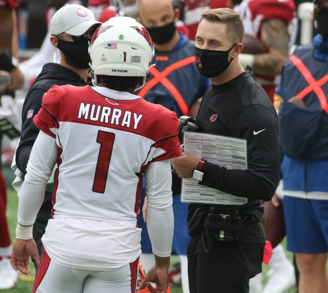Kyler Murray quarterback of the Cardinals with his head coach Kliff Kingsbury in the first half of the game between the Arizona Cardinals and the New York Jets at MetLife Stadium on October 11, 2020.