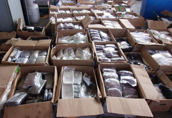 Part of a haul of methamphetamine and heroin found at the Otay Mesa border crossing on Oct. 9, 2020, is displayed in a photo from the U.S. Customs and Border Protection agency. Officials said it was the second-largest seizure at the southwestern border and they valued it at $7.2 million.