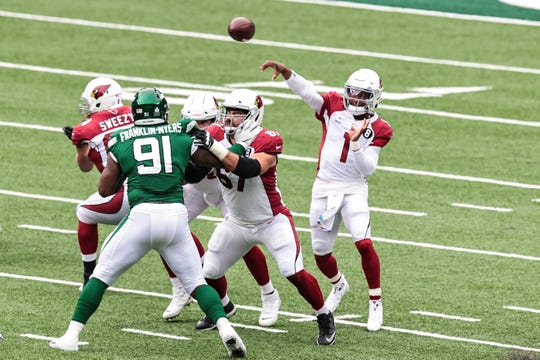 Oct 11, 2020; East Rutherford, New Jersey, USA; Arizona Cardinals quarterback Kyler Murray (1) throws the ball as New York Jets defensive end John Franklin-Myers (91) defends during the first half at MetLife Stadium. Mandatory Credit: Vincent Carchietta-USA TODAY Sports