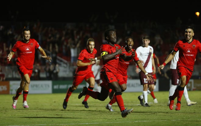 Phoenix Rising's Solomon Asante celebrates with his teammates after scoring the game winning goal against Sacramento Republic FC during extra time at Casino Arizona Field in Tempe, Ariz. on Oct. 10, 2020.
