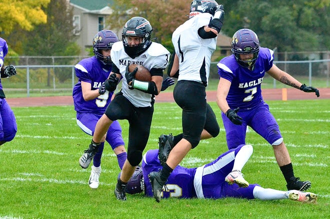Marine City's Anthony Rentzel rushes during a Macomb Area Conference-Silver football game on Saturday, Oct. 10, 2020, at Madison Heights Madison.