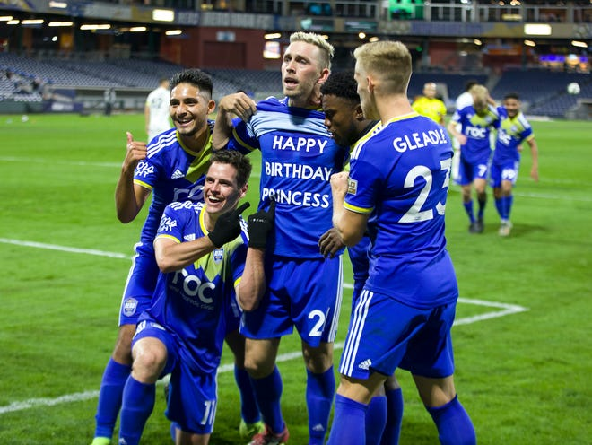 Reno 1868 FC players celebrate the team's win Saturday night in the opening round of the USL playoffs.