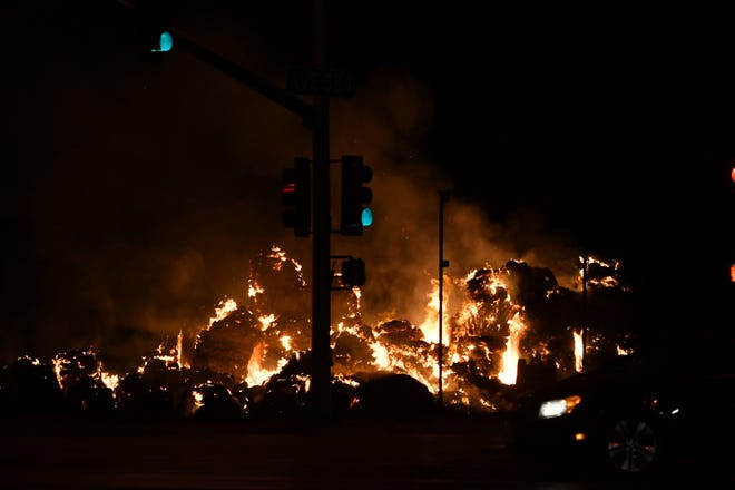 Arsonists have torched dozens of hay bales sporting Devin Nunes and Donald Trump signs for the second time in as many weeks.The hay fire was reportedaround 9:45 p.m.Saturday. It burned for hours on Avenue384 and Road 80, near Dinuba.