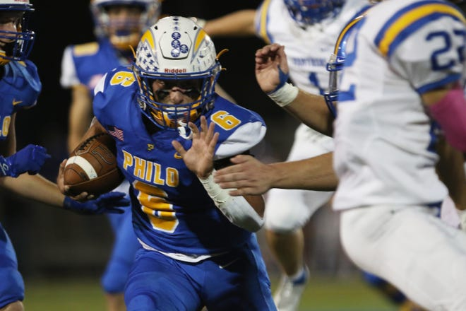 Philo's Casey Munyan carries the ball against Maysville.