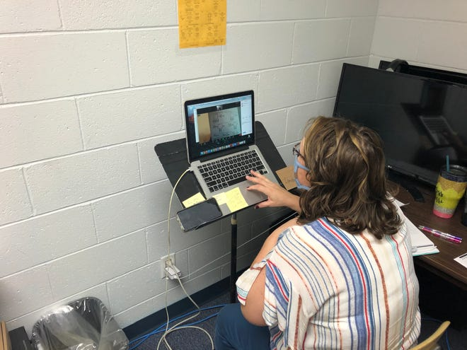 A remote learning teacher at Bancroft-Rosalie Schools checks an elementary student's work on Zoom.
