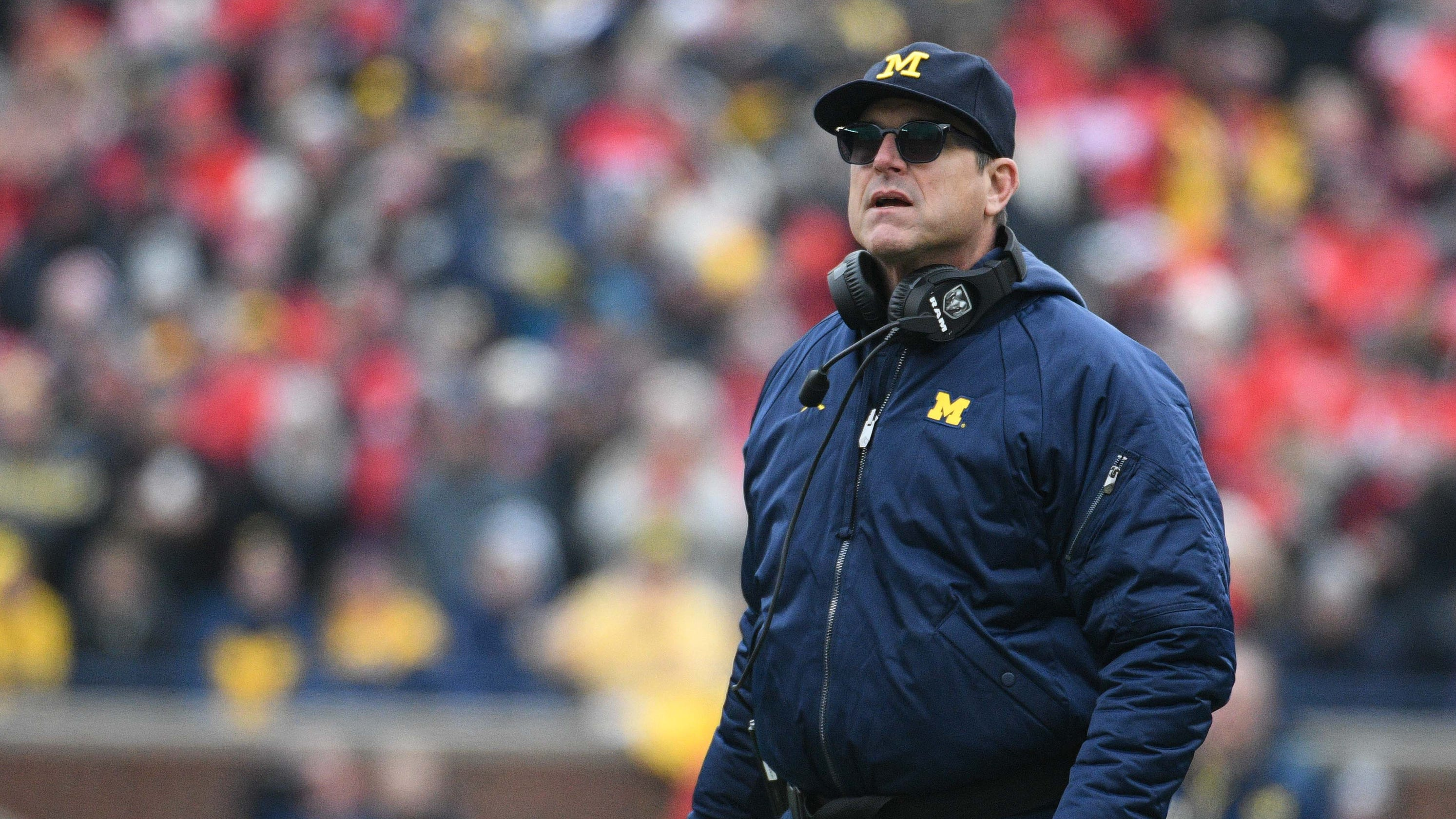 Michigan football coach Jim Harbaugh signs extension through 2025 at lower base salary