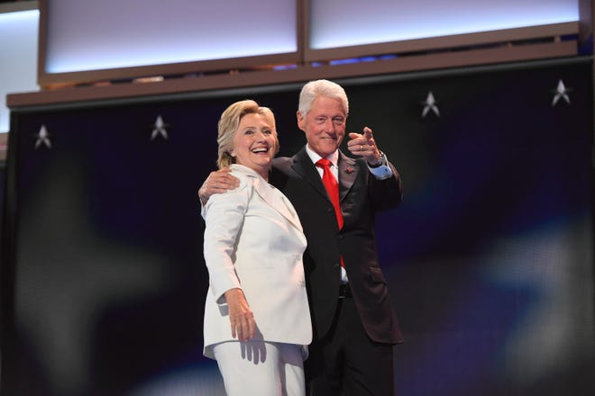 Hillary Clinton appears with her husband, former President Bill Clinton, after accepting the Democratic nomination for president in 2016. Most polls showed her way ahead of Republican rival Donald Trump.
