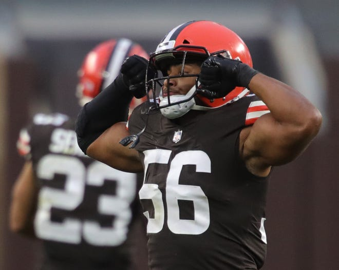 Cleveland Browns outside linebacker Malcolm Smith (56) celebrates after breaking up a pass during the second half of an NFL football game, Sunday, Oct. 11, 2020, in Cleveland, Ohio. [Jeff Lange/Beacon Journal]