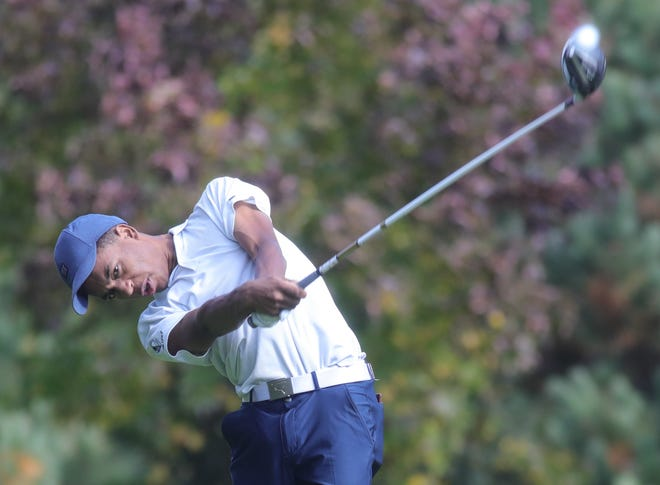 Hoban's Solomon Petrie follows his tee shot on the 11th hole during the Division I District on Monday in Hinkley.