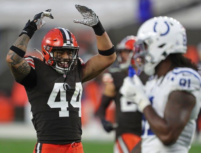 Browns linebacker Sione Takitaki (44) gets the crowd pumped up during the second half of an NFL football game, Sunday, Oct. 11, 2020, in Cleveland, Ohio. [Jeff Lange/Beacon Journal]