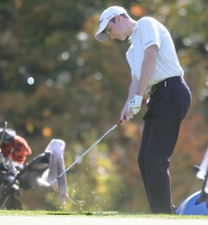 Jackson's Ben Ramold chips onto the No. 10 green during the Boys Division I District Golf Tournament on Monday, Oct. 12, 2020 in Hinkley, Ohio, at Pine Hills Golf Course. [Phil Masturzo/ Beacon Journal]