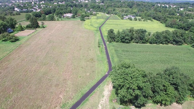 An aerial view of a new hike and bike trail segement through open space between the intersections of Mill Creek and Pickertown roads to Stump and Pickertown roads.