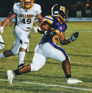 South Beauregard running back Malachi McElhaney (20) breaks free around the right end for a big gain in the Golden Knights' 58-56 win over Iota on Wednesday. McElhaney accounted for 189 yards rushing and three touchdowns in the victory.